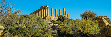Ruined Temple of Heracles columns in ancient Valley of Temples, Agrigento, Sicily, Italy. Wide banner.