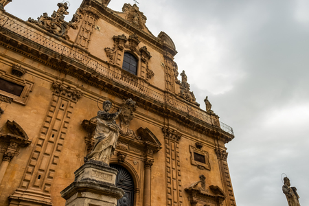 Baroque Church of San Pietro in Modica, exterior detail with statue of saint, Ragusa, Sicily, Italy.