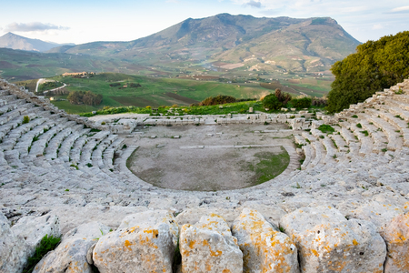 ancient Greek theatre, panorama view of beautiful mountains from the last row, Segesta village, Sicily, Italy