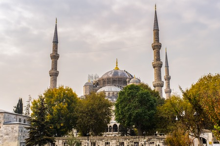 Hagia Sophia domes and minarets in the old town of Istanbul with tourists, Turkey