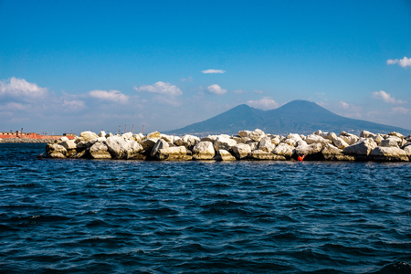 Landscape of Mount of Vesuvius from coast sea in Naples city. Italian holiday.