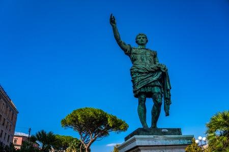 Roman emperor bronze statue on blue sky background in Naples Foto de archivo