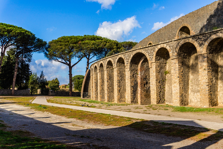 Ancient arena in the ruins of Roman Imperial city Pompeii near volcano Vesuvius, Italy