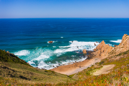 Beach among rocks - Ursa Beach near Cape Roca, Cabo da Roca, at Atlantic Ocean coast in Portugal.