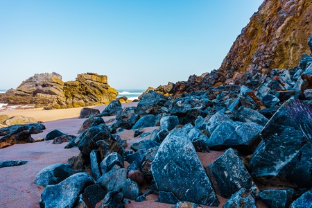 Cliff rocks on the west Atlantic coast of Portugal in Alentejo region, Portugal