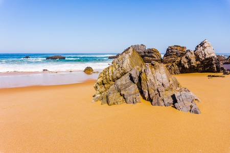Beautiful sandy beach with rocks on Atlantic coast, Adraga beach, Portugal 写真素材