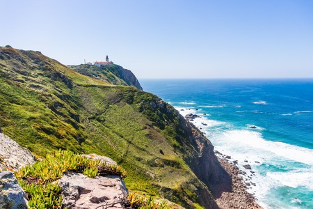 Portugal. Cabo da Roca and the lighthouse over Atlantic Ocean, the most westerly point of the European mainland.