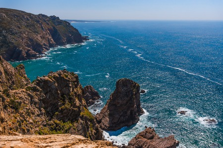 Landscape of rocky coastline on Atlantic coast at sunny day, Portugal