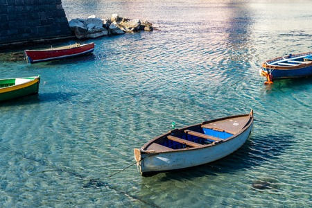 View of old wooden boat moored in little bay in Italian city, Europe 写真素材