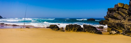 Rocky coastline of sandy Adraga beach Atlantic ocean, Portugal Atlantic coast. Wide banner.
