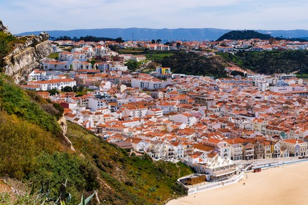 The town and beach of Nazare in Portugal on the shores of the Atlantic Ocean on a sunny day