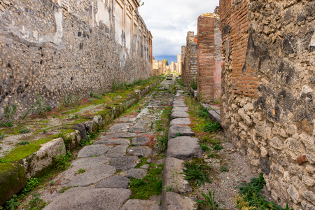 Way to the horizon in Ruins of ancient city of Pompeii near volcano Vesuvius, Naples, Italy.