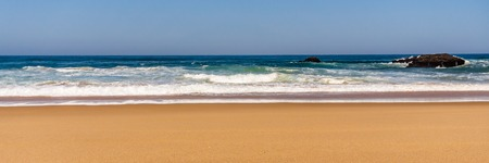 Sandy beach with Rock formation, Atlantic ocean coastline of Adraga beach, Portugal. Wide banner. 写真素材
