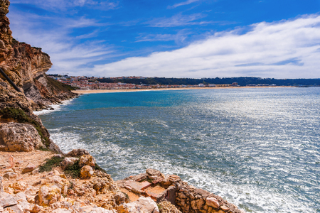 Panoramic landscape coastline of Atlantic ocean. View Nazare from sea. Portugal
