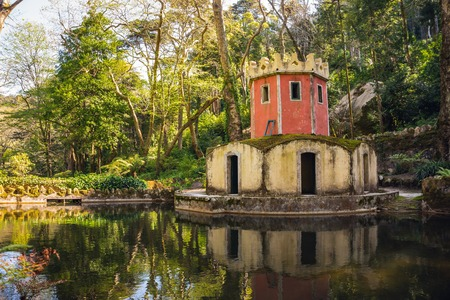 Tower in the pond. Park of the Palacio Nacional de Pena, Sintra, Portugal