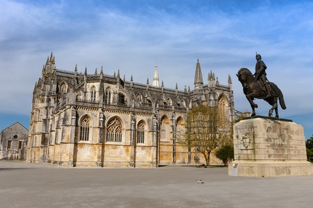 Statue of Nuno Alvares Pereira in front of the Batalha Monastery of Santa Maria da Vitoria. Portugal. Gothic and Manuelino aka Manueline style