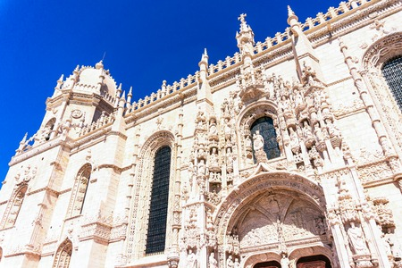 Facade of the church of Santa Maria de Belem and Monastery of Jeronimos in Lisbon, Portugal