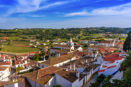 The ancient streets and houses of Portuguese village of Obidos. Portugal discovery. 写真素材