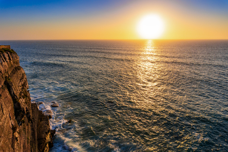 Atlantic ocean coast at sunset, Algarve, Portugal. Stunning beautiful landscape