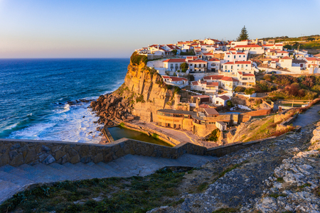 Small Portugal village Azenhas do Mar on cliff on coastline, near Lisbon with a beautiful sunset. Portugal.