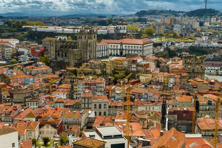 Aerial cityscape image of Porto, Portugal with the Porto Cathedral and old town