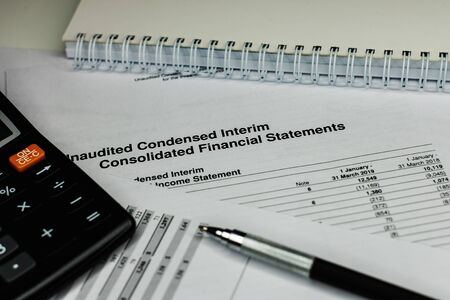 Financial analysis - income balance statement, business plan with glass. Business composition of Investment portfolio.