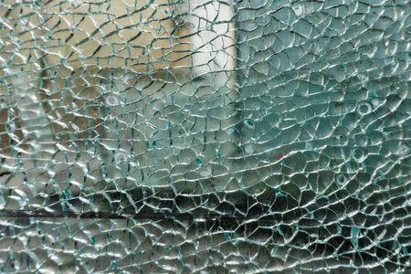 cracks on glass texture broken glass transparent. Background.