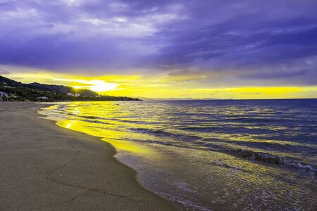 Beautiful colorful sunrise at the sea with dramatic clouds and sun shining Stok Fotoğraf