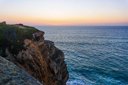 Sunset at Atlantic ocean rocky coast , Portugal. Stunning beautiful landscape