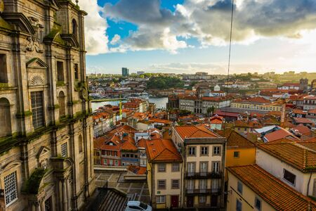 The red roofs of Porto in historical district at sunset. Portugal Stock Photo