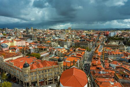 Stunning panoramic aerial view of traditional historic buildings in Porto. Vintage houses with red tile roofs