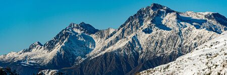 High mountains under snow in the winter. Wide banner