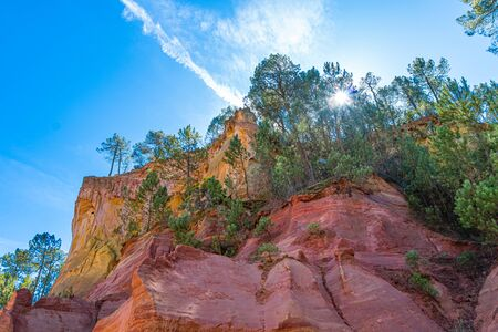 Roussillon, red rocks colorful ochre canyon in Provence, France.