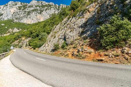 Narrow road in Verdon Gorge national park in French Alps Фото со стока
