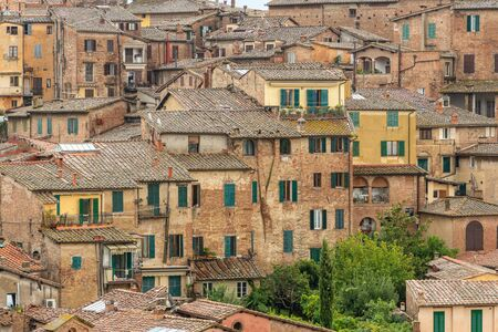 Pattern houses beackground, Old residential houses in medieval city of Siena, Italy