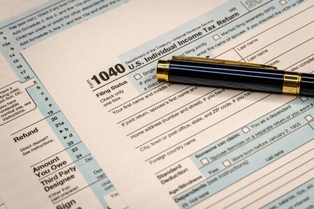 Tax Time Gives the Choice to File On-line or by Mail. Concept Image. Tax time.
