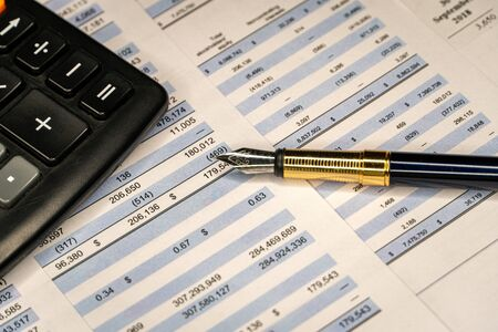 Pen, calculator On the financial account documents, the financial report. Accounting balance.