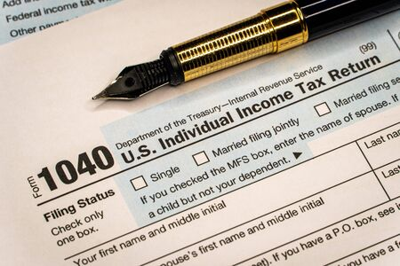 Fountain pen on the Tax forms 1040. U.S Individual Income Tax Return. Tax time.