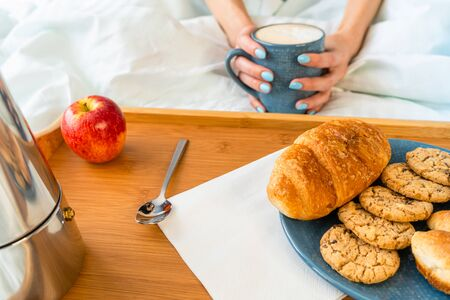 Happy attractive woman wake up in the morning in bed. Good morning and fresh and beautiful breakfast on tray for the girl Stock Photo