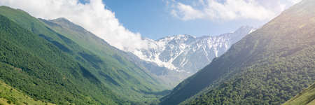 Mountain landscape with green meadow. Mountains valley panorama of Caucasus, wide banner background