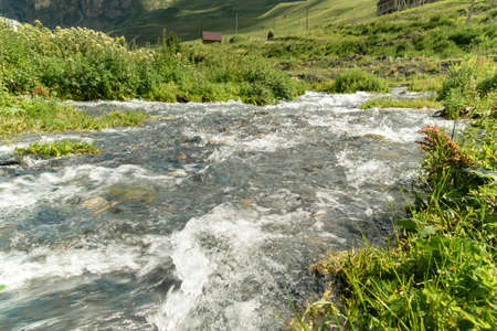 Water in mountain river from glacier on valley. Beautiful landscape Caucasus Reklamní fotografie