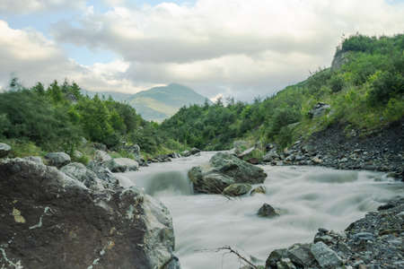 Water in mountain river from glacier on valley. Beautiful landscape Caucasus in North Ossetia