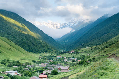 Fantastic view of highest mountain village in north ossetia in mountains with cloudy sky.