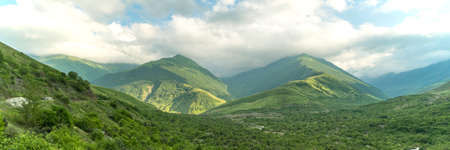 Fantastic view of mountains in north ossetia with cloudy sky. Concept of travel the world. Russia.