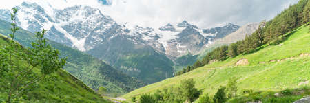 Mountain valley and glacier on background. Beautiful travel landscape of Caucasus.