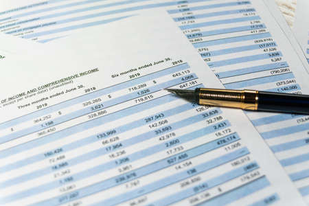 Financial budget statement, numbers for analysis invest stock. Accounting business plan concept. Selective focus