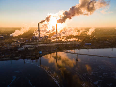 Aerial view Forward Cityscape sunrise Factory chimney smoke building steam thermal power plant Stock fotó