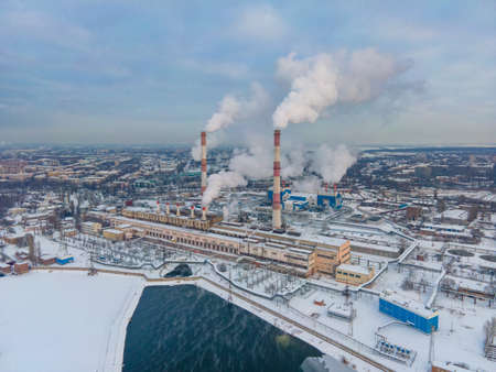Factory smoke pipes pollute atmosphere with smoke ecology pollution, Industrial factory chimney pollutes Reklamní fotografie