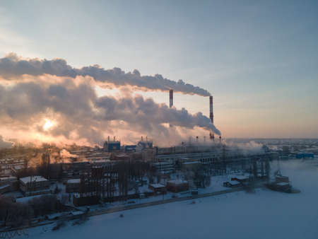 Aerial view of Industrial plant pipe and Global warming concept. Air pollution by smoke of the factory chimneys in the industrial zone