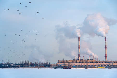 Emission smoke from factory pipes in Industrial zone. Pollution of the air atmosphere, environment and ecology crisis, climate change, global warming Stock fotó